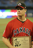 March 7, 2009:  First baseman Justin Morneau (33) of Canada receives the Lionel Conacher Award presented to the Canadian Male Athlete of the Year selected by the Canadian Press prior to the first round of the World Baseball Classic at the Rogers Centre in Toronto, Ontario, Canada.  Team USA defeated Canada 6-5 in both teams opening game of the tournament.  Photo by:  Mike Janes/Four Seam Images