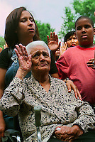 (SWR01-070299) New York, NY -- 2JULY99 -- 500 New American Citizens raise their right hands in an oath and Pledge of Allegiance for the first time at a massive naturalization ceremony at Central Park's Nuremburg Bandshell. Honorable Harold Baer, jr.US District Court Judge for the Southern District of New York State, who presided over the ceremony, noted it was the last Independence Day of the century.