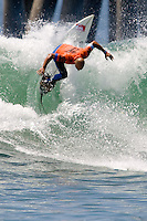 American Kelly Slater turns off the top during round of 96 at the 2010 US Open of Surfing in Huntington Beach, California on August 4, 2010.