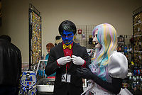 NWA Democrat-Gazette/CHARLIE KAIJO Spencer and Paige Hunt of Rogers dressed as characters from the show Don't Hug me I'm scared shop on Sunday, November 12, 2017 at Four Points Sheraton Hotel in Bentonville. The Hotel hosted the Arkansas Anime Festival - Northwest Arkanas Edition 2017. Fans enjoyed product displays, gaming parties and artist Q&As