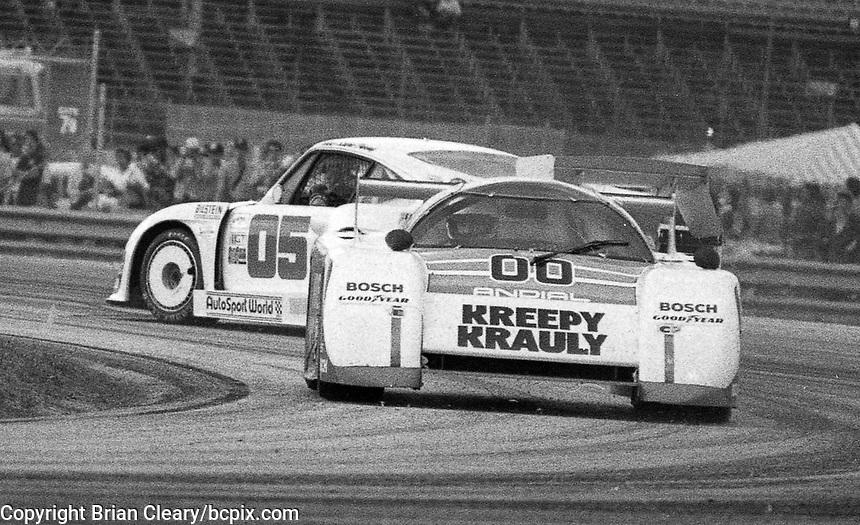 The #00 March-Porsche 83G of Sarel van der Merwe, Graham Duxbury and Tony Martin avoids a spinning Porsche as it races to victory in the SunBank 24 at Daytona, Daytona International Speedway, Daytona Beach, FL, Feb. 4-5, 1984. (Photo by Brian Cleary/www.bcpix.com)