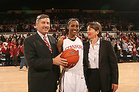31 January 2008: Stanford Cardinal director of athletics Bob Bowlsby (left) and head coach Tara VanDerveer (right) presents Candice Wiggins (center) with the game ball after breaking Stanford's all-time leading scoring record (Kate Starbird's mark of 2,215, set from 1993-1997) during Stanford's 77-51 win against the USC Trojans at Maples Pavilion in Stanford, CA. Wiggins finished the game with 18 points and 2,222 career points.