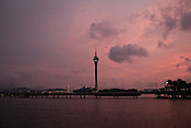 A view of the Macau seafront and the Macau Tower in Macau, China.