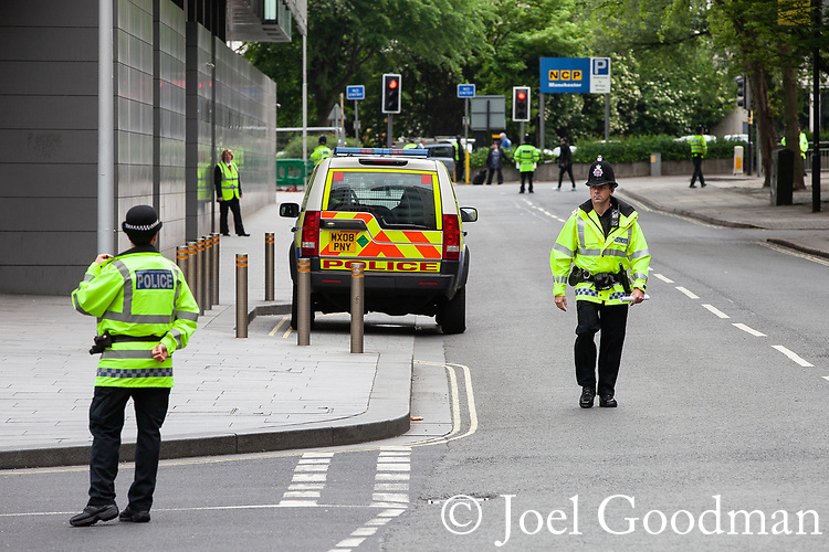 © Joel Goodman - 07973 332324 . 01/06/2012. Manchester , UK. Police outside Manchester Crown Court , ahead of the arrival of a prison van believed to be carrying Kiaran Stapleton , the man accused of murdering Indian student Anuj Bidve on Boxing Day 2011 . Photo credit : Joel Goodman