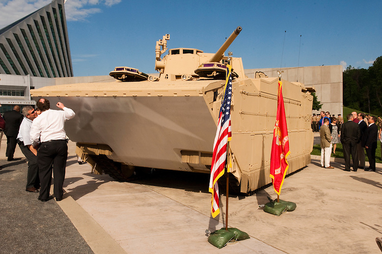 """WASHINGTON, DC - May 4: The U.S. Marines' newest Expeditionary Fighting Vehicle (EFV) prototype sits in front of the National Museum of the Marine Corps in Triangle. Va., before its unveiling ceremony. The armored amphibious vehicle is designed carry 17 combatants, plus a three person crew, from Navy ship """"beyond the horizon"""" to objectives inland. The ceremony was held at the(Photo by Scott J. Ferrell/Congressional Quarterly)"""