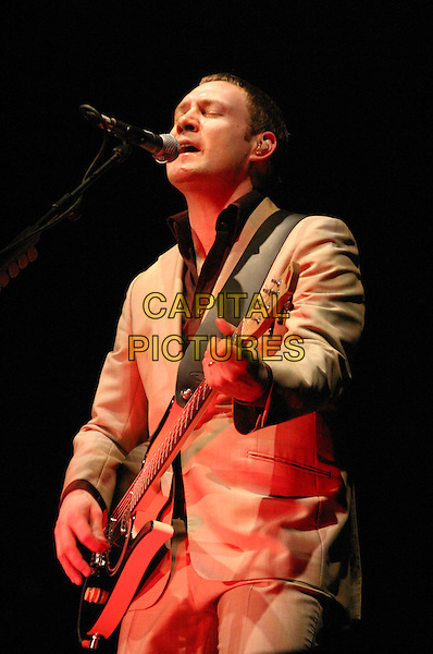DAVID GRAY.David Gray Live at Nottingham Arena, Nottingham..UK, United Kingdom..10th December 2005.Ref: JEZ.half length performing live onstage on stage singing playing acoustic guitar guitarist microphone music gig concert show .www.capitalpictures.com.sales@capitalpictures.com.©Capital Pictures