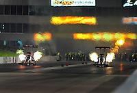 May 20, 2011; Topeka, KS, USA: NHRA top fiel dragster driver Terry McMillen (left) races alongside David Grubnic  during qualifying for the Summer Nationals at Heartland Park Topeka. Mandatory Credit: Mark J. Rebilas-