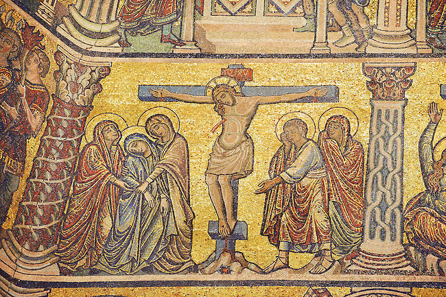 The Medieval mosaics of the ceiling of The Baptistry of Florence Duomo ( Battistero di San Giovanni ) showing Jesus Christ on the cross,  started in 1225 by Venetian craftsmen in a Byzantine style and completed in the 14th century. Florence Italy