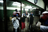 Warsaw 04.2009 Poland<br /> Since the early 50' ties &quot;Gwardia&quot; has been famous for bringing up world boxing champions. The famed sports hall located by pl. Zelaznej Bramy in Warsaw witnessed trainings of Jerzy Kulej, the Skrzeczowie brothers, last Polish olympic champion Jerzy Rybicki or its most recent star Krzysztof &quot;Diablo&quot; Wlodarczyk. The club prides of numerous sport achievements, among others, 15 olympic medals (6 gold), over 60 medals from European and World Championships and over 100 from Championships of Poland.<br /> Today, only three small training halls remain from the former times of glory.<br /> One of the most famous in Polish history boxing section of Warsaw's &quot;Gwardia&quot; awaits its liquidation. This &quot;Mecca&quot; of Polish boxing is to be replaced by a huge supermarket,  decisions imposed by Warsaw authorities.<br /> ( Photo: Adam Lach / Napo Images )<br /> <br /> Juz od wczesnych lat 50. Gwardia slynela z wychowywania swiatowych mistrzow bokserskich. W hali przy pl. Zelaznej Bramy trenowali Jerzy Kulej, bracia Skrzeczowie, ostatni polski mistrz olimpijski w boksie Jerzy Rybicki czy obecna gwiazda ringu Krzysztof &quot;Diablo&quot; Wlodarczyk. Klub moze poszczycic sie wieloma osiagnieciami sportowymi, do kt&oacute;rych przede wszystkim zaliczyc nalezy: 15 medali olimpijskich (w tym 6 zlotych), ponad 60 medali Mistrzostw Swiata i Europy i ponad 1000 medali Mistrzostw Polski. Teraz z dawnej swietnosci pozostaly zaledwie trzy male salki. Jedna z najslyniejszych w historii Polski sekcja bokserska Gwardii Warszawa ma byc zlikwidowana. Decyzja wladz Warszawy, te swego rodzaju mekke polskiego boksu ma zastapic wielki market<br /> (Fot Adam Lach / Napo Images )