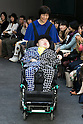 Disabled model Taichiro Inote sits on a wheelchair and poses on the catwalk wearing clothes from the tenbo 2016 Spring-Summer Collection during the Mercedes-Benz Fashion Week Tokyo, in Roppongi on October 13, 2015, Tokyo, Japan. tenbo invited people with disabilities to join models and celebrities on the runway in a message of peace. The Mercedes-Benz Fashion Week Tokyo runs from October 12 to 17. (Photo by Rodrigo Reyes Marin/AFLO)
