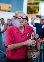 Sep 15, 2019; Mohnton, PA, USA; NHRA team owner Don Schumacher celebrates with the trophy as he smokes a cigar after winning the Reading Nationals at Maple Grove Raceway. Mandatory Credit: Mark J. Rebilas-USA TODAY Sports