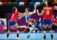 25 JUL 2012 - LONDON, GBR - Marie Gerbron (GBR) of Great Britain (centre) shoots during the women's London 2012 Olympic Games warm up handball match against Spain at The Copper Box in the Olympic Park, in Stratford, London, Great Britain .(PHOTO (C) 2012 NIGEL FARROW)