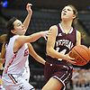 Julia Rawlinson #14 of Mepham, right, looks to drive to the net as Jess Tolve #1 of MacArthur defends against her during a Nassau varsity girls basketball game played at NYCB Live's Nassau Coliseum in Uniondale on Saturday, Dec. 23, 2017. Rawlinson recorded 18 points and 12 rebounds in Mepham's 45-40 win.