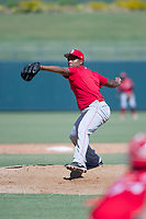 Cincinnati Reds pitcher Wendolyn Bautista delivers a pitch to the plate during an Instructional League game against the Kansas City Royals on October 2, 2017 at Surprise Stadium in Surprise, Arizona. (Zachary Lucy/Four Seam Images)