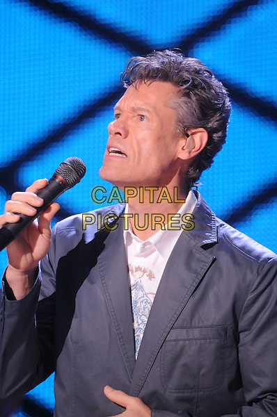 RANDY TRAVIS.2008 CMA Music Festival Nightly Concert held at LP Field, Nashville, Tennessee, USA..June 8th, 2008.stage concert live gig performance music half length grey gray suit jacket microphone singing .CAP/ADM/MS.©Mike Strasinger/AdMedia/Capital Pictures.