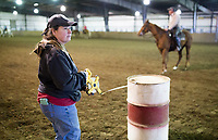 """NWA Democrat-Gazette/CHARLIE KAIJO Jeanie Sims, president of the Northwest Arkansas Horse Show Association, adjusts the position of a riding barrel, Sunday, March 25, 2018 at the Benton County Fairgrounds in Bentonville. <br /><br />The Benton County Fairgrounds partnered with the Northwest Arkansas Horse Show Association to provide an arena for riders to bring their horses. <br /><br />""""This is a testing the waters kind of thing. WeÕd like to do more of these open ride events, enjoy the fairgrounds and the nice arena,"""" said Susan Koehler, fair and events manager of the Benton County Fairgrounds. """"Especially like today's rainy day. This is an opportunity for them to ride.""""<br /><br />The next event is on April 14. It will include a large horse show with barrel racing, pole bending speed events and an open horse show with judged events like English, Western Pleasure and Ranch Horse events."""