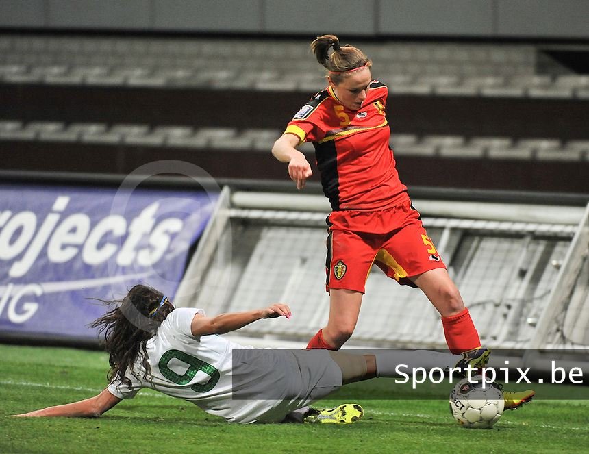20131031 - ANTWERPEN , BELGIUM : Belgian Lorca Van De Putte (right) pictured trying to avoid the tackle of Portugese Ana Borges (9)  during the female soccer match between Belgium and Portugal , on the fourth matchday in group 5 of the UEFA qualifying round to the FIFA Women World Cup in Canada 2015 at Het Kiel stadium , Antwerp . Thursday 31st October 2013. PHOTO DAVID CATRY