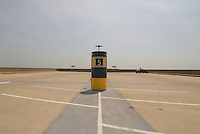 Parking pylon on top level of a nearly empty short term parking garage at an airport