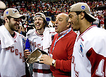 MILWAUKEE, WI - APRIL 8: Athletic director Barry Alvarez of the Wisconsin Badgers mingles with players after they beat the Boston College Eagles during the NCAA Frozen Four Finals on April 8, 2006 at the Bradley Center in Milwaukee, Wisconsin. Wisconsin beat Boston College 2-1. (Photo by David Stluka)