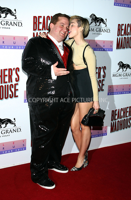 WWW.ACEPIXS.COM<br /> <br /> December 27 2013, Las Vegas<br /> <br /> Jeff Beacher and Miley Cyrus arriving at the unveiling of Beacher's Madhouse Las Vegas at the MGM Grand Hotel &amp; Casino on December 27, 2013 in Las Vegas, Nevada.<br /> <br /> By Line: Nancy Rivera/ACE Pictures<br /> <br /> <br /> ACE Pictures, Inc.<br /> tel: 646 769 0430<br /> Email: info@acepixs.com<br /> www.acepixs.com