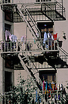 San Francisco China town with laundry on clothes line hanging on outside fire escape California USA