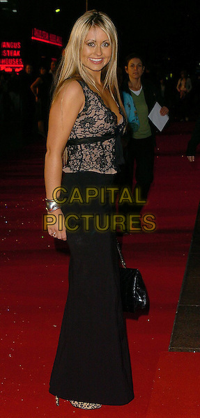 "SARAH BARRAND.""In Her Shoes"" UK Premiere.UK,  United Kingdom.7th November 2005.Ref: CAN.full length black lace dress smiling posed.www.capitalpictures.com.sales@capitalpictures.com.©Capital Pictures"