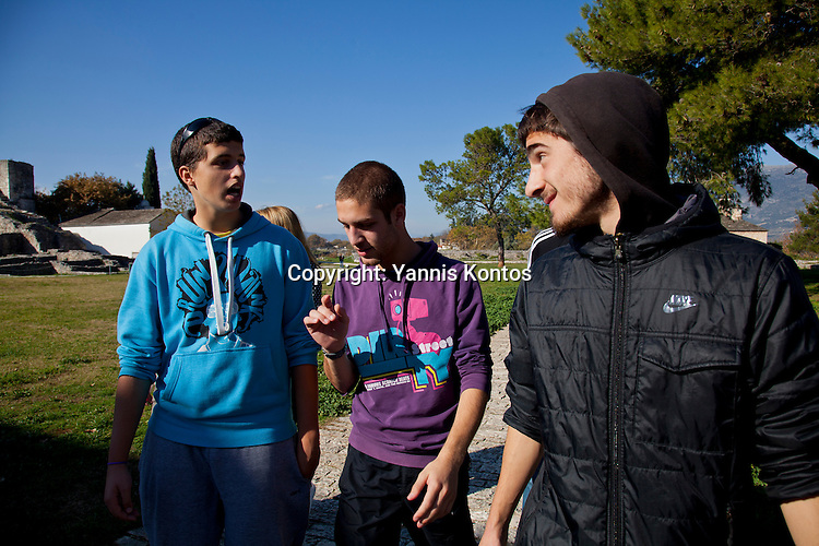 Greek students from left:  Andreas Nasios,18, Christos Dimitriadis,18, and Dinos Athanasiou,18, relax from their lessons near by the Ioannina lake.