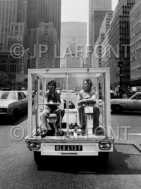 Manhattan, NYC, May, 1970. The French Actress Marlene Jobert visiting Manhattan in a &ldquo;fish tank car&rdquo; designed by Quasar Khanh on a Mini Austin chasis.<br /> <br /> Manhattan, NYC, Mai 1970. La vedette du cin&eacute;ma fran&ccedil;ais Marl&egrave;ne Jobert venue &agrave; New York pr&eacute;senter son dernier film Le passager de la pluie, a choisi pour visiter la ville de fa&ccedil;on originale la voiture Aquarium. Elle r&eacute;alis&eacute;e par Quasar Khanh sur une plateforme Austin Mini.