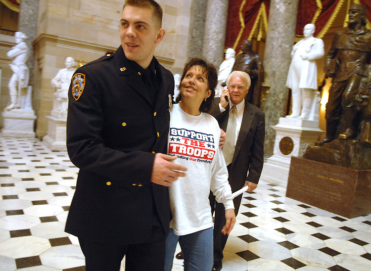 Former marine Cpl. Richard Baker, now a New York City police officer, walks through Statuary Hall with Beverly Young, wife of Rep. Bill Young, R-Fla., right.  Beverly Young met Baker at National Naval Medical Center, Bethesda, while he was recovering from malaria that he contracted while deployed in Liberia.