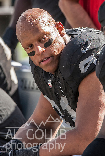 Oakland Raiders defensive end Jack Crawford (91) talks to other players on Sunday, September 23, 2012, in Oakland, California. The Raiders defeated the Steelers 34-31.  .