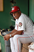 Tri-City ValleyCats manager Ed Romero (48) in the dugout during a game against the Batavia Muckdogs on August 2, 2014 at Joseph L. Bruno Stadium in Troy, New  York.  Tri-City defeated Batavia 8-4.  (Mike Janes/Four Seam Images)