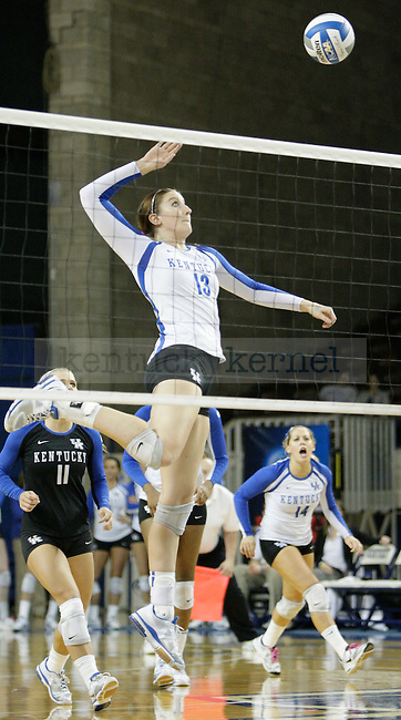 Freshman Kayla Tronick (13) spikes the ball during the UK women's volleyball game v. East Tennessee University during the NCAA tournament in Memorial Coliseum in Lexington, Ky., on Friday, November 30, 2012. Photo by Genevieve Adams | Staff