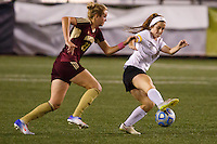 Penn's Brooke VanDyck (7) plays the ball away from Brebeuf Jesuit's Alia Martin (23) during the IHSAA Class 2A Girls Soccer State Championship Game on Saturday, Oct. 29, 2016, at Carroll Stadium in Indianapolis. Special to the Tribune/JAMES BROSHER
