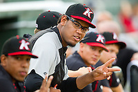 Jefferson Olacio (40) of the Kannapolis Intimidators mugs for the camera prior to the South Atlantic League game against the Savannah Sand Gnats at CMC-Northeast Stadium on August 20, 2013 in Kannapolis, North Carolina.  The Sand Gnats defeated the Intimidators 5-2.  (Brian Westerholt/Four Seam Images)
