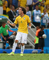 David Luiz of Brazil celebrates scoring his goal to make the score 2-0