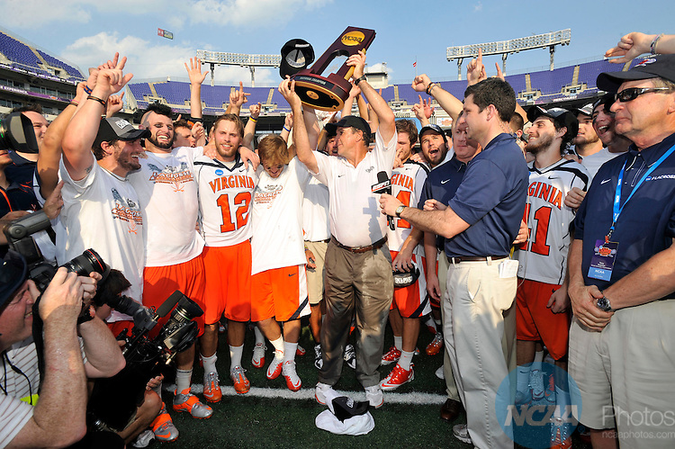 30 MAY 2011:  Head Coach Dom Starsia of the University of Virginia receives the championship trophy after defeating the University of Maryland during the Division I Men's Lacrosse Championship held at M+T Bank Stadium in Baltimore, MD.  Virginia defeated Maryland 9-7 for the national title. Larry French/NCAA Photos