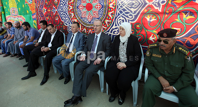 Palestinian Prime Minister Rami Hamdallah visits the mourning tent of Hussein family in the West bank city of Ramallah on July 06, 2015. Photo by Prime Minister Office