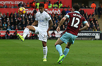 Kyle Naughton of Swansea City is closely marked by Robbie Brady of Burnley during the Premier League match between Swansea City and Burnley at The Liberty Stadium, Swansea, Wales, UK. Saturday 06 March 2017