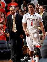 CHARLOTTESVILLE, VA- DECEMBER 6: Jontel Evans #1 of the Virginia Cavaliers walks past head coach Paul Hewitt of the George Mason Patriots during the game on December 6, 2011 at the John Paul Jones Arena in Charlottesville, Virginia. Virginia defeated George Mason 68-48. (Photo by Andrew Shurtleff/Getty Images) *** Local Caption *** Paul Hewitt;Jontel Evans