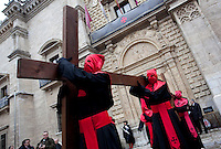 Members of a brotherhood file carrying a cross on hteir shoulders through the streets of Valladolid during a procession in the Holy Week of Spain. Valladolid, Spain. March 28, 2013 (Victor Blanco/ Alterphotos) /NortePhoto