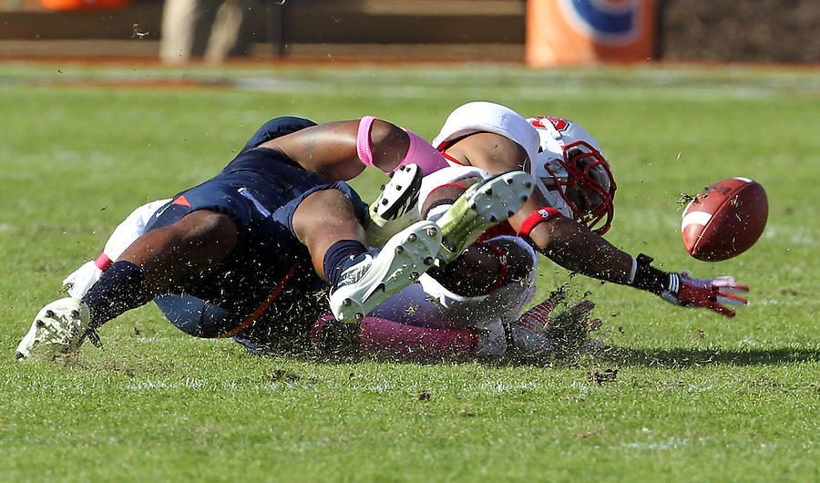 Oct. 22, 2011 - Charlottesville, Virginia - USA; North Carolina State wide receiver Bryan Underwood (80) losses control of the ball with Virginia Cavaliers safety Corey Mosley (7) during an NCAA football game at the Scott Stadium. NC State defeated Virginia 28-14. (Credit Image: © Andrew Shurtleff