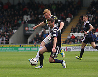 Conor Newton tackles Stuart Kettlewell (4)in the St Mirren v Ross County Scottish Professional Football League Premiership match played at St Mirren Park, Paisley on 3.5.14.