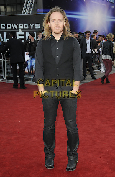 TIM MINCHIN.UK Premiere of 'Cowboys and Aliens' at the Cineworld cinema at the O2 Arena, London, England..August 11th 2011.full length waistcoat grey gray shirt stubble facial hair hands in pockets jeans denim.CAP/CAN.©Can Nguyen/Capital Pictures.