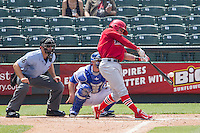 Memphis Redbirds shortstop Greg Garcia #5 swings the bat during the Pacific Coast League baseball game against the Round Rock Express on April 27, 2014 at the Dell Diamond in Round Rock, Texas. The Express defeated the Redbirds 6-2. (Andrew Woolley/Four Seam Images)