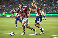 Colorado Rapid midfielder Pablo Mastroeni (25) moves past Chivas USA defender Jimmy Conrad (12) during the first half of the game between Chivas USA and Colorado Rapids at the Home Depot Center in Carson, CA, on March 26, 2011. Final score Chivas USA 0, Colorado Rapids 1.