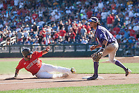 Texas Tech Red Raiders outfielder Tyler Neslony (10) slides as TCU Horned Frogs third baseman Elliott Brazilli (3) looks on during Game 3 of the NCAA College World Series on June 19, 2016 at TD Ameritrade Park in Omaha, Nebraska. TCU defeated Texas Tech 5-3. (Andrew Woolley/Four Seam Images)