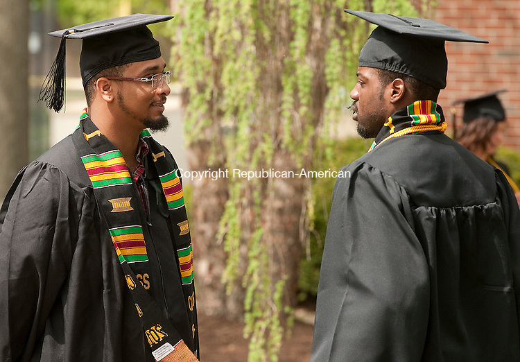 WATERBURY, CT--050915JS01-  Alexander L. Adams, left, of Hartford chats with fellow graduate Temitayo Adeosun of Brooklyn, NY, right, prior to the start of Post University's 2015 Commencement Saturday at Post University in Waterbury. Adams received his Bachelor of Science degree in Business Administration and Adeosun received his Bachelor of Science degree in Criminal Justice. <br /> Jim Shannon Republican-American