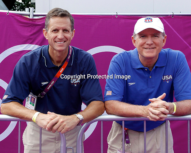 Dr. Scott Rodeo and John Cavanaugh watch USA swimmer Alex Mayer compete in the Men's Swimming Marathon at the London Olympics on Friday, August 10, 2012, in London, England (AP Photo/Margaret Bowles)