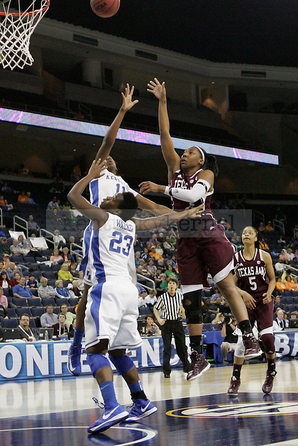 TAMU center Kelsey Bone makes a shot against UK defense by forward Samarie Walker and center DeNesha Stallworth during the second half of the University of Kentucky women's basketball game vs. Texas A&M University during the SEC Tournament Championship Game at The Arena at Gwinnett Center in Duluth, Ga. on Sunday, March 10, 2013. Texas A&M won 75-67. Photo by Genevieve Adams | Staff