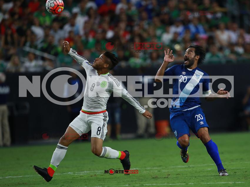 Jonathan DOS Santos y Carlos Ruiz de Guatemala   ,durante partido entre las selecciones de Mexico y Guatemala  de la Copa Oro CONCACAF 2015. Estadio de la Universidad de Arizona.<br /> Phoenix Arizona a 12 de Julio 2015.